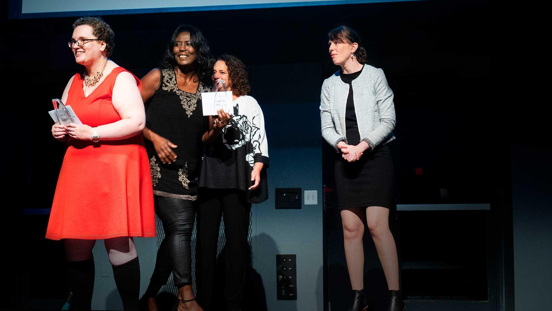 Individual holding award for inspiring change awards Cota event