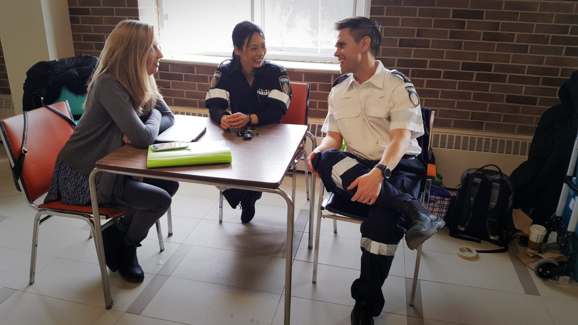 Sarah, Jessie and Michael sitting in a CPLC clinic space