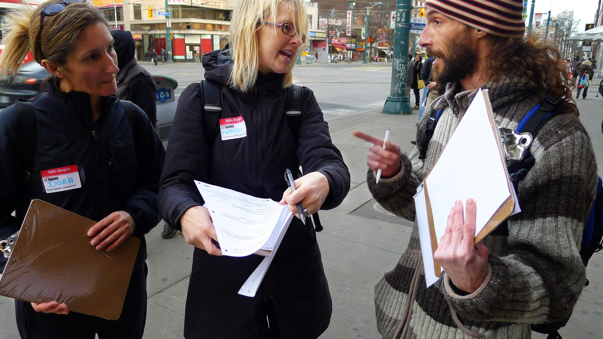 Photo of street needs assessor talking to someone in the community